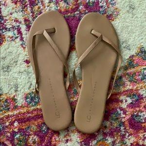 Tan flip flops